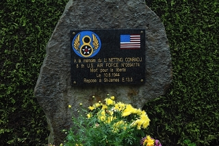 Memorial to an American airman outside country graveyard near St James, France